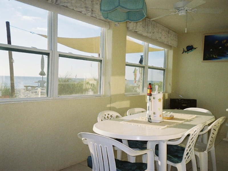 large lanai enjoy all your meals looking out over the beach and Gulf of Mexico