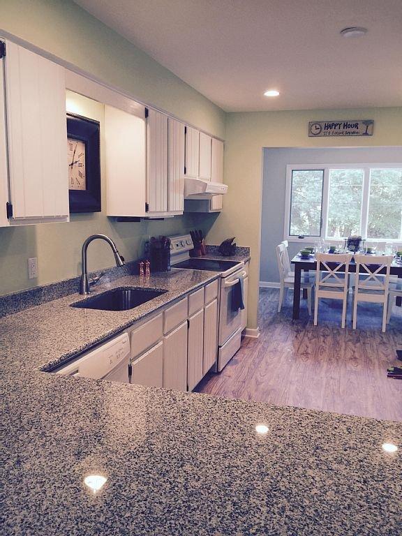 Kitchen, new floor, paint, lights, counters, etc