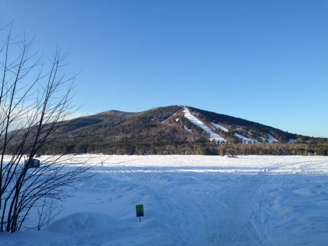 Snowmobile trails on the frozen lake.  Shawnee peak in the background