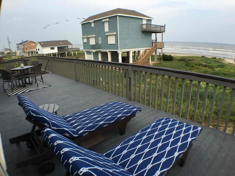 You'll love sitting on the lounge chairs watching the waves.