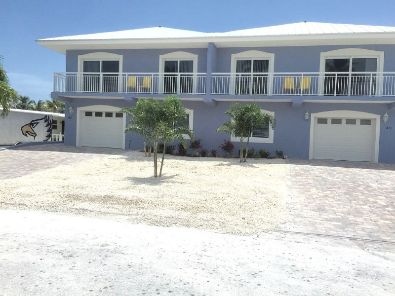 NEW 4 Bedroom,4 Bath with private pool and 37 and 1/2 foot boat dock, holiday rental in Key Colony Beach