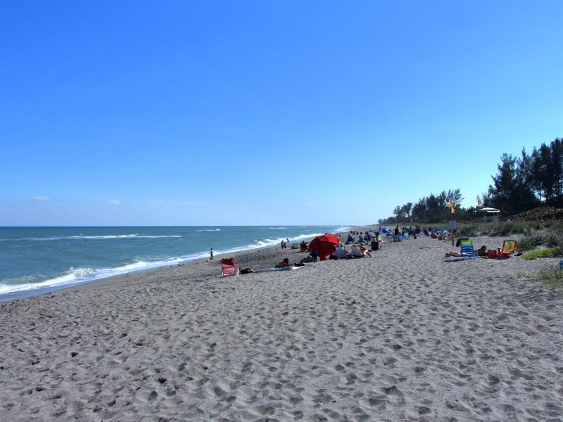 Hobe Sound public beach with lifeguard, just less than a mile away.