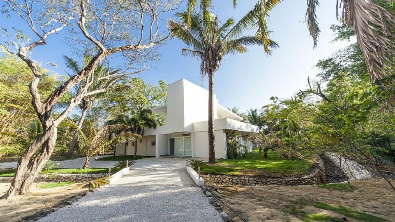 private & gated modern home with direct beach access