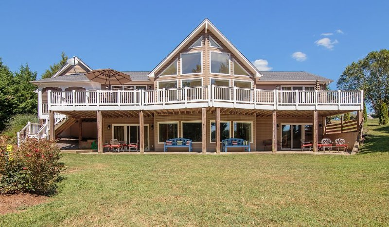 60' Deck, Patio, over looking the lake w/seating for 24, + screen porch
