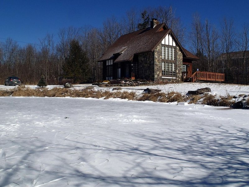 View of the house across the frozen pond