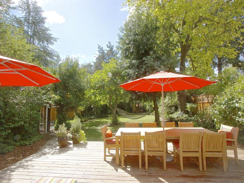 The outside deck, an oasis with table for 10, chaise loungers, and hammock.