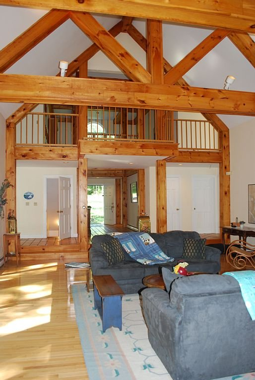 Breathtaking and bright great room facing the ocean with fireplace and pine beams