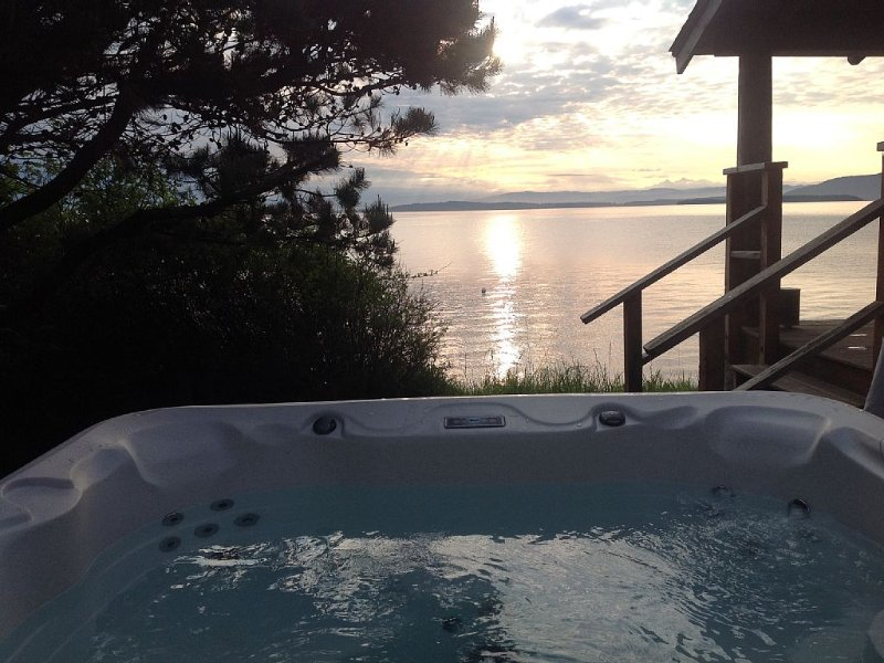 Soak in the hot tub while you soak up the view