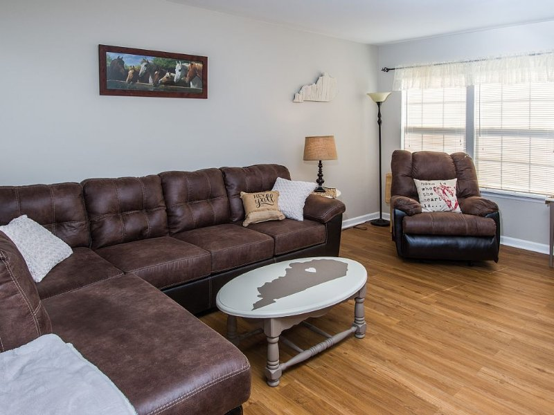 """Cozy living space with a 52"""" flat screen smart TV."""