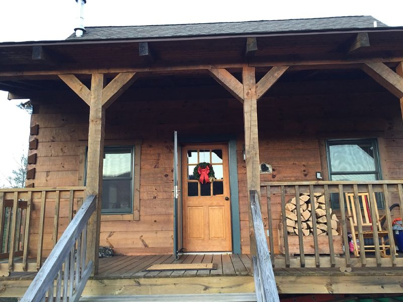 Front porch of cabin -  Enjoy your morning coffee with a view of the mountains.