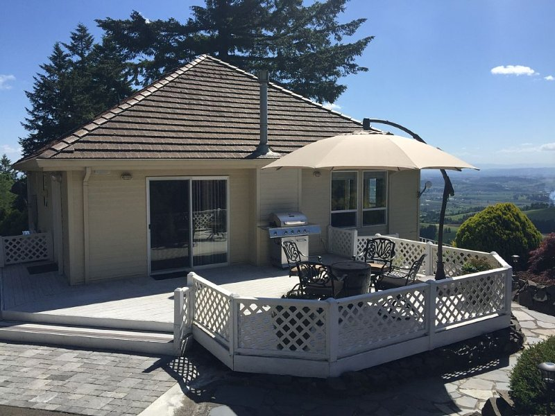 Patio area with Gas Firepit, Umbrella, Chairs and Gas BBQ Grille