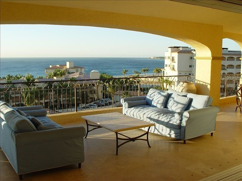 Large private shaded balcony overlooking pool and ocean w/ wet bar & gas grill