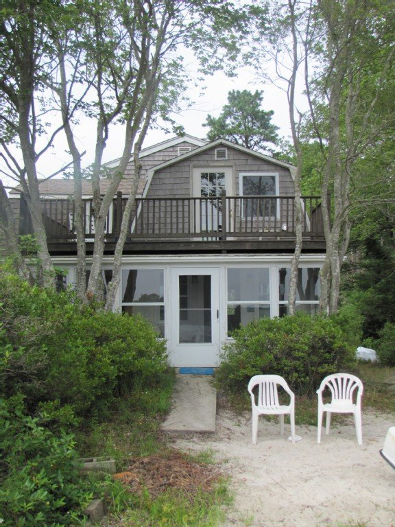 Steps from private sandy beach on Micajah Pond with beach fire pit.