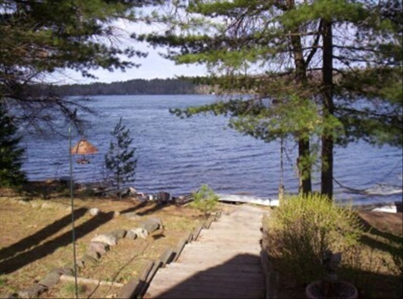 Bass Lk~Eagle River~Level to Water~Beautiful Sand Beach Front, vacation rental in Eagle River