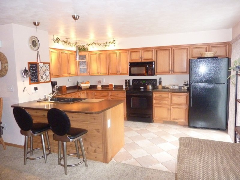 Pecan Finished custom cabinets and upgraded appliances. Gas Grill/outside deck