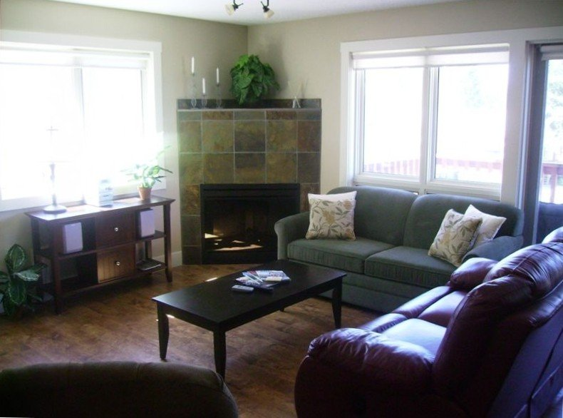 Relax in comfort in this cozy space with plenty of windows & balcony access