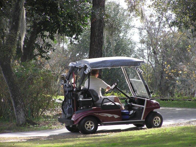 Golfers Just Outside Condo Unit