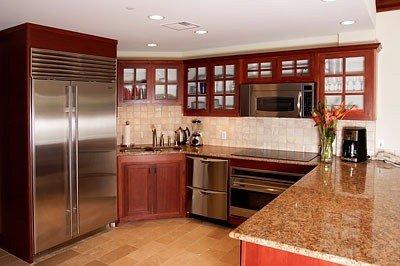 For the discriminating chef: Wolf stovetop, sub-zero fridge & granite counters
