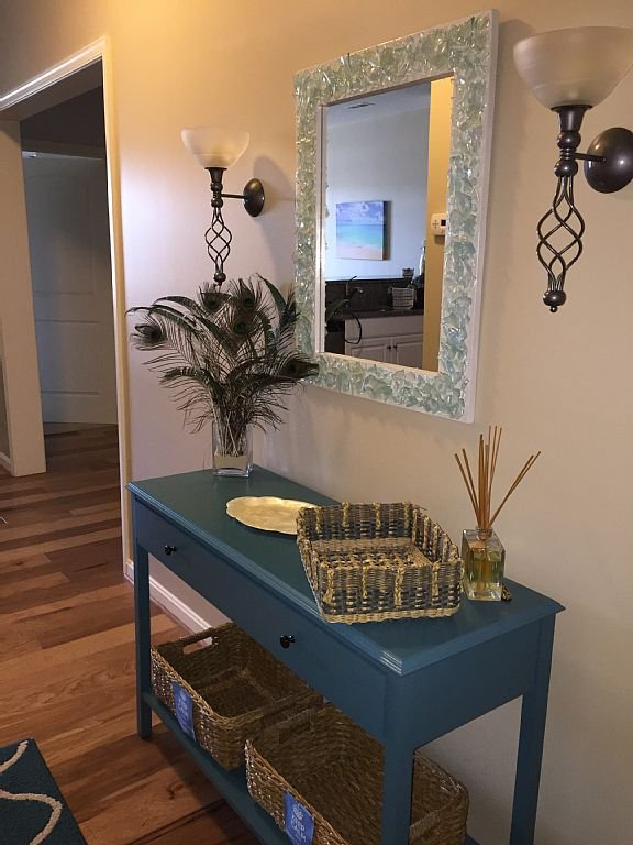 entrance way with sea glass mirror instantly puts you in the beach frame of mi