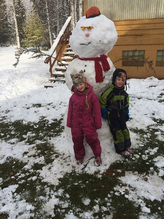 The first snowman of the season with 2 guests that helped make it.