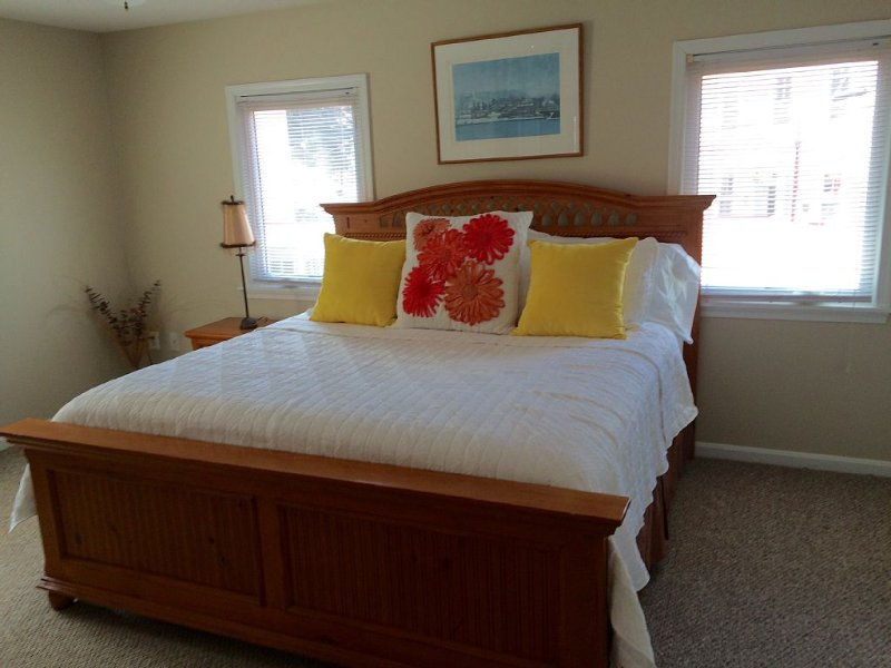 Large bedroom with King Size bed. Bright and airy with a closet and dresser.