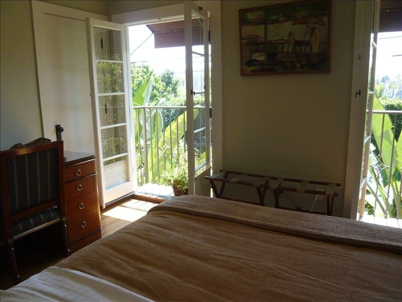 3rd bedroom queen size bed w/view of backyard and pool