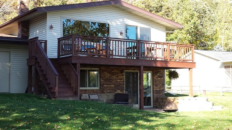 Enjoy the view to the Cove and beyond to the lake from the balcony or the patio.