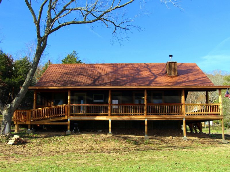 Screened-in porch of cabin.