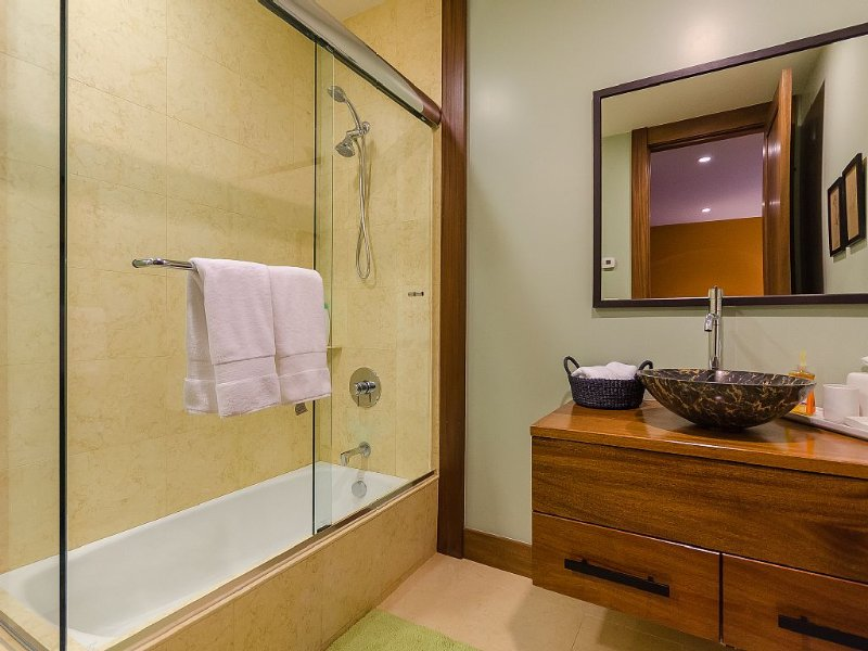 Room with two queen beds has its own bathtub and shower