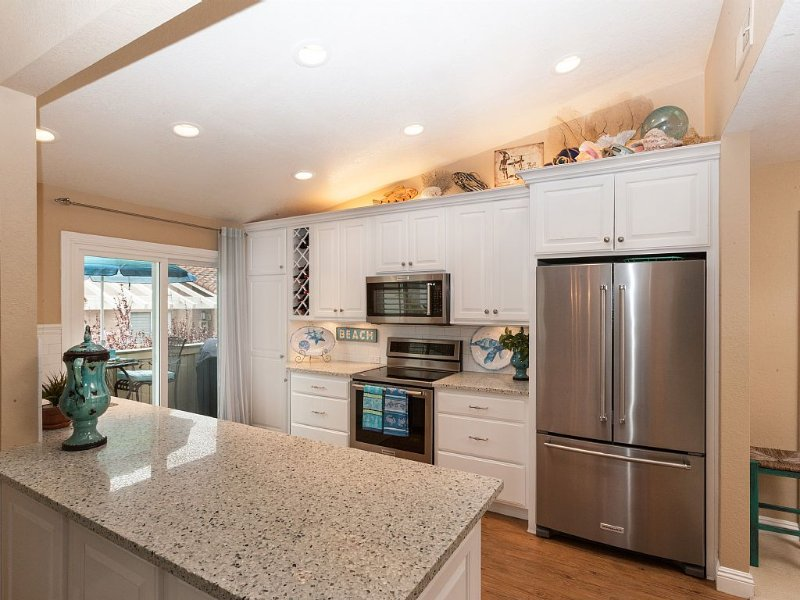 Highly upgraded custom kitchen.   Gorgeous beach glass counter tops.