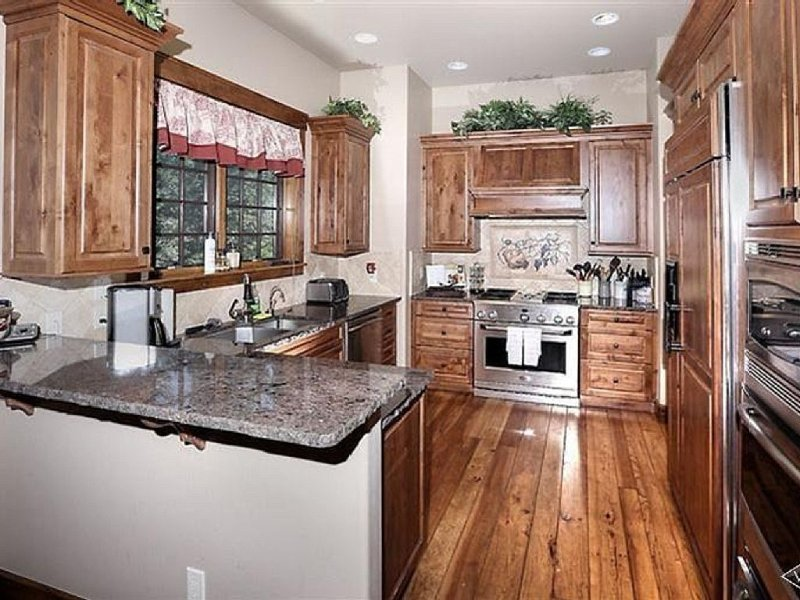 Chefs kitchen, with all cooking utensils, pots and pans, granite countertops