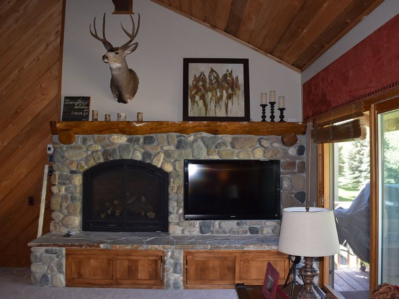 Gas fireplace and large TV in the family are perfect for cozy nights at home