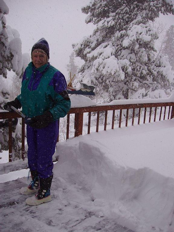 Mom shoveling snow!