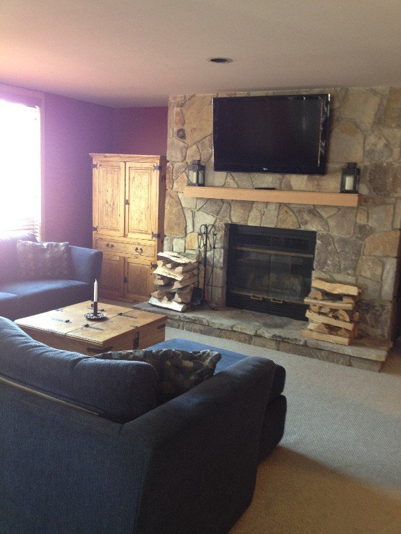 Living room with fireplace and big screen TV!