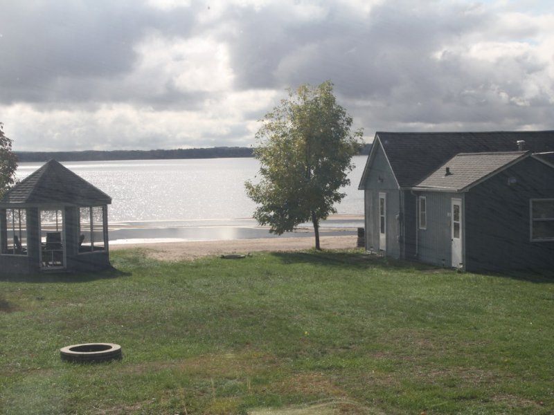 The beach is calling...right outside your window... come relax and play!, vacation rental in Shell Lake