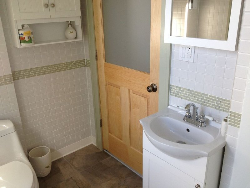 tiled bathroom, native maple door with frosted glass