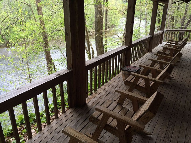 3 bedrooms open onto lower deck with plenty of rockers to enjoy the river