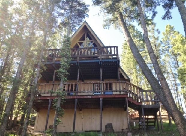 Chalet cabin, 4 bedrooms, near golf course , 5 minutes to ski area., alquiler de vacaciones en Angel Fire