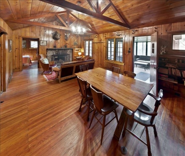 Combined Rustic Living room and Dining room, all Knotty Pine Interior