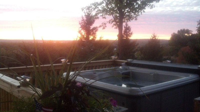 Hot Tub with panoramic sunset view from front of chalet