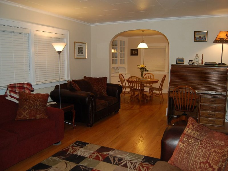 Living room with restored 1920s oak hardwood flooring throughout the house!