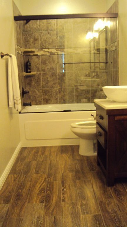 Freshly remodeled master bath!  Jacuzzi tub, tile surround w/ dual vanities.