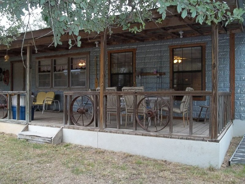 Wake up to the peace and quite of the morning with a cup of coffee on the porch., holiday rental in Zephyr