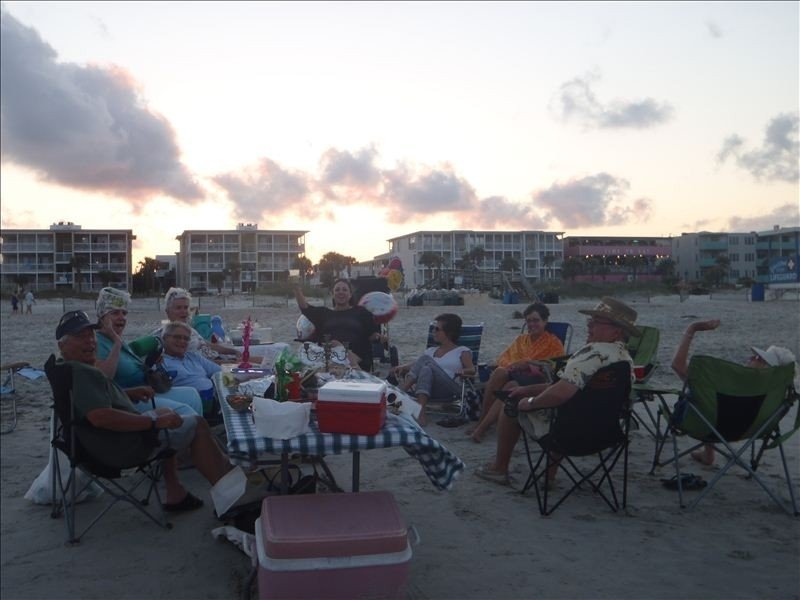 Sunset picnic on the beach-the condo is close enough for bathroom breaks.