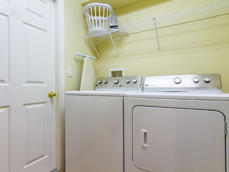 Laundry room with large capacity washer and dryer