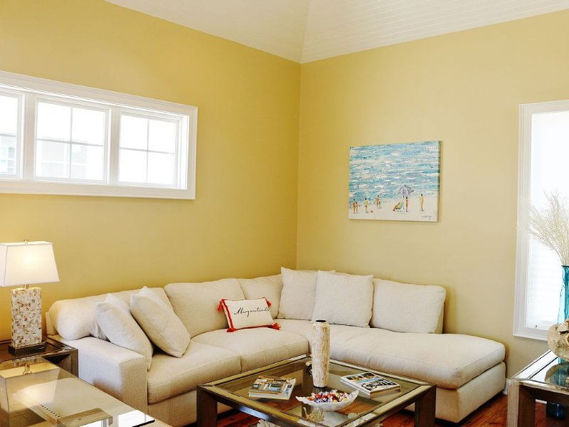 Family Room with Designer Coach, Hand Paintings and Flat Screen TV