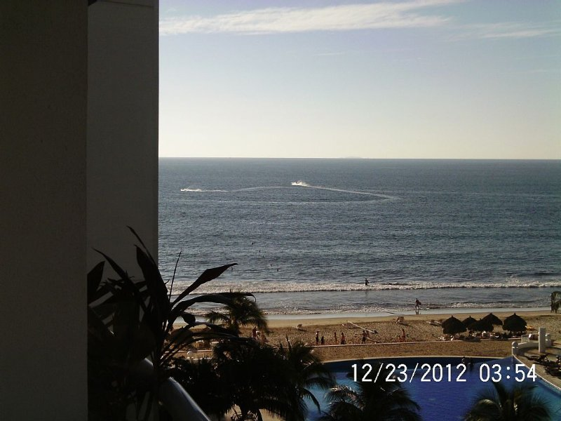 View from balcony of the beach with volleyball, Jetskis, palapas, Banderas Bay