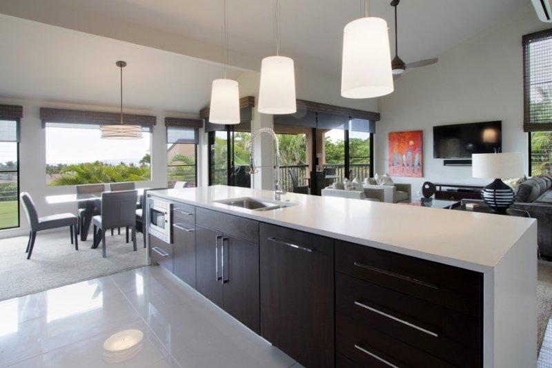 Quartz countertops, stainless steel appliances, marble floors.