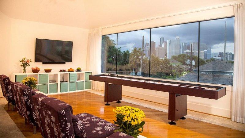 12' shuffleboard table w/55' smartTV in top floor ent. room adjacent roof deck