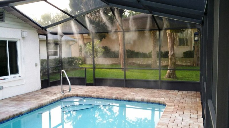 Heated, saltwater pool with misting system.